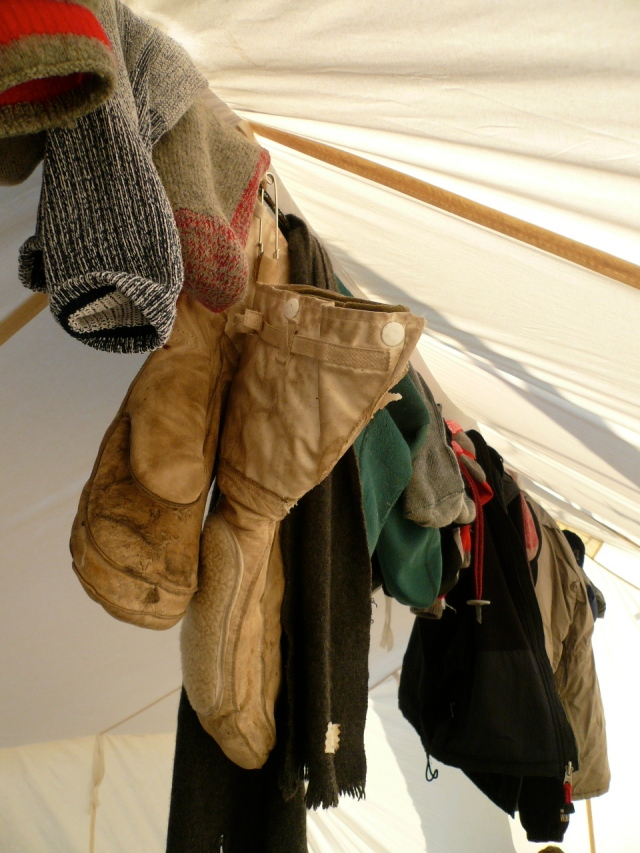 Clothes drying on the line in the peak of the tent