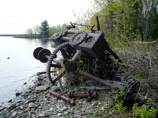 Rusted tow-boat on shore of Farm