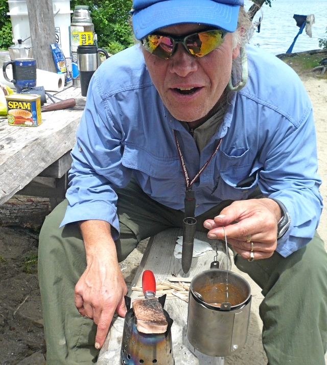 Tom grillin' Spam and boilin' up soup