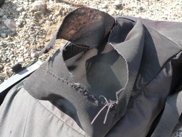 Torn water bottle pocket