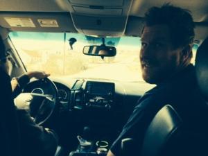 John riding shotgun